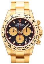 Rolex Cosmograph Daytona Sort/18 karat gult gull